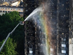 Firefighters spray water after a fire engulfed the 24-storey Grenfell Tower in west London.  PRESS ASSOCIATION Photo. Picture date: Wednesday June 14, 2017. At least 12 people have died after the huge fire destroyed a tower block in west London, with the death toll expected to rise. See PA story FIRE Grenfell. Photo credit should read: Victoria Jones/PA Wire